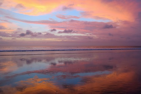 Empty Kuta beach with amazing colors sunset and sky reflection, Bali, Indonesia Stock Photo