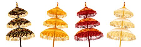 Colorful Balinese traditional religious three-tiered umbrellas set isolated on white background, vector decoration illustration
