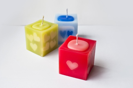 colourful aroma candle white heart pattern photo
