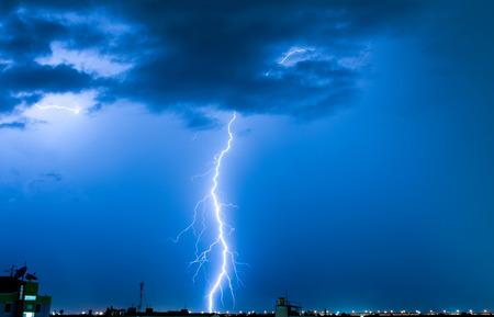 Severely lightning, thundering down the center town. Stock Photo
