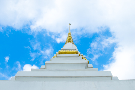 White plastered pagoda decorated with golden yellow with a sharp tip in the sky. Stock Photo