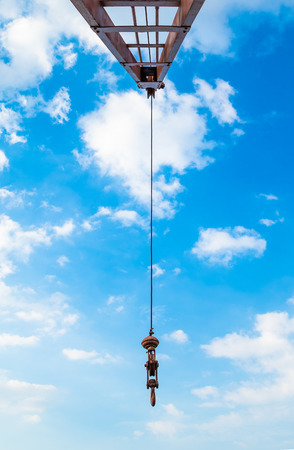savety: Steel hook are attached with a sling with steel beams and sky background. Stock Photo