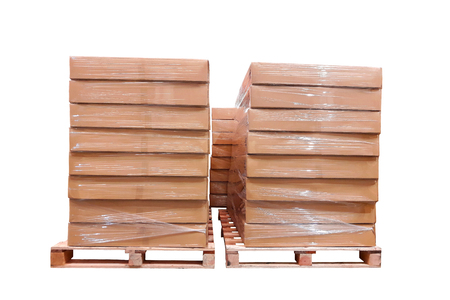 terraced: Cardboard boxs cover with plastic on a wooden pallets isolated. White background.
