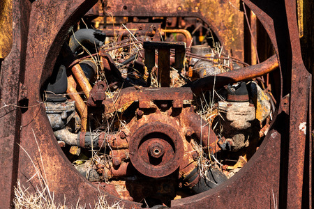 Close up view of Pulley and engine is old and deteriorate rusty thick. Place it outdoors. Stock fotó