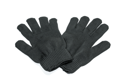 Close up and top view two black cloth gloves for hand wear on white floor. Stock Photo