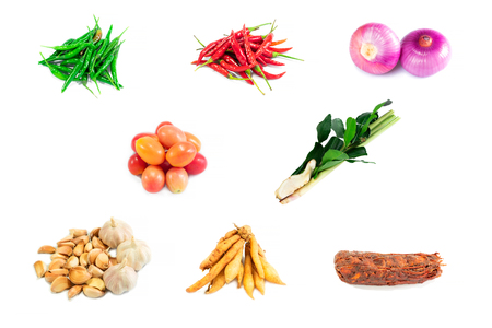 Top view and merging. Spices fresh vegetables set for cooking. Isolated on white background.