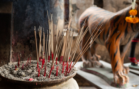 Close up view and copy space. Incense sticks in a pot to bless the sacred. The religious beliefs of Buddhists.