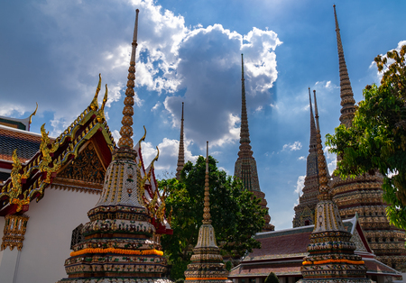 Old pagoda decorated with elaborate. Is large beautiful sharp tip in the sky. Is placed of religious and public place for general people either Thai and foreign visitors. Banco de Imagens