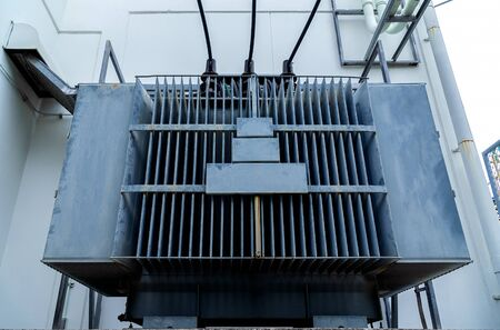 Low view of large power transformers for supplying electricity of industrial plants.