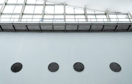 Overexposed view. Ceiling there are vents and receiving light inside the building.