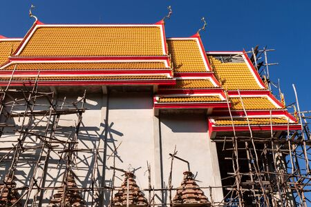 The scaffolding on around the chapel of temple is under construction.