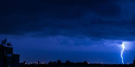 Copy space of severely lightning thundering down at the night with.