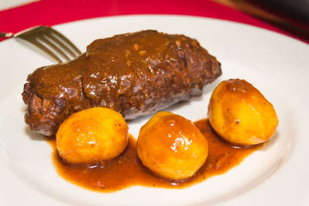 butcher s shop: served roulades with potatoes on plate