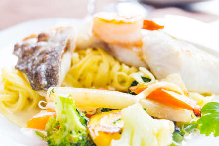 menue: dish fish served on plate