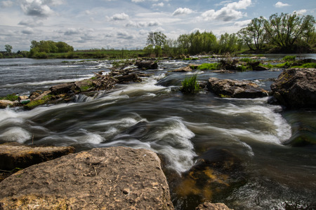 inanimate: rapids on the river in the summer,beautiful clouds Stock Photo