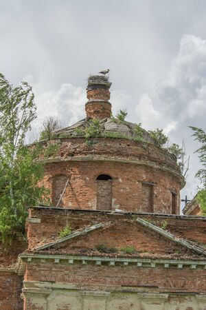 Travel to Russia. Stork on the ruined dome of the church, Summer Russia. June 2019