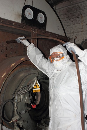 An engineer wearing ppe for a boiler clean photo