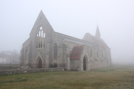 portsmouth: The bomb damaged garrison church of old portsmouth during a foggy day