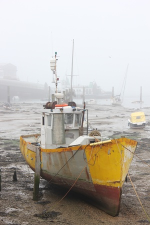 Fishing boat of portsmouth on a foggy day
