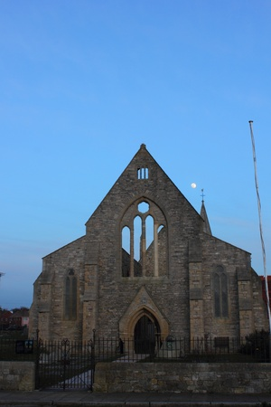 bombed city: The bomb damaged garrison church with the moon in the background, portsmouth england, uk