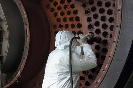 an industrial steam boiler being cleaned Standard-Bild