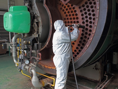 an industrial steam boiler being cleaned Stock Photo