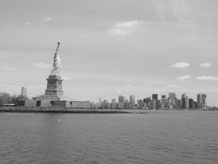 Statue of liberty with newyork skyline photo
