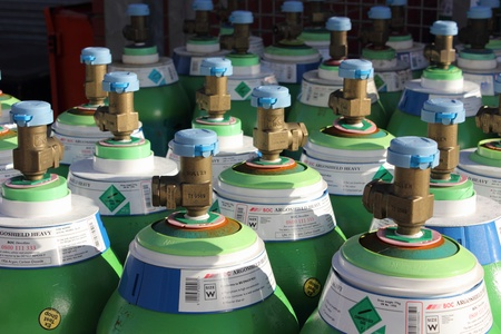 18th: full gas bottles ready for use on an industrial site in portsmouth, england,18th november 2012