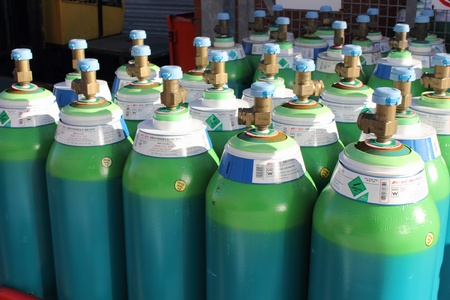 full gas bottles ready for use on an industrial site in portsmouth, england,18th november 2012