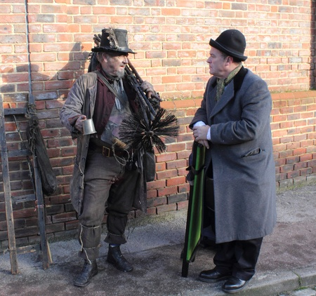 Victorian chimney sweep wearing his old clothes & carrying his brushs,portsmouth,1st december 2012 Editorial