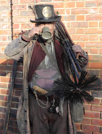 Victorian chimney sweep wearing his old clothes & carrying his brushs,portsmouth,1st december 2012