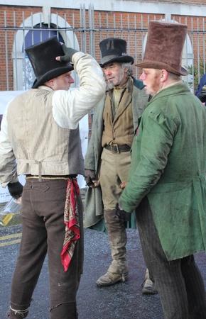 courteous: Victorian men at a christmas fair in portsmouth dockyard,1st december 2012