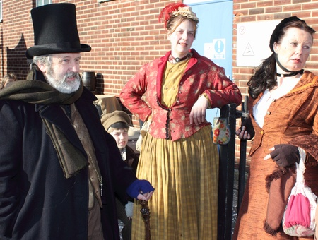 Victorians dressed for a day out at a fair in portsmouth dockyard,1st december 2012