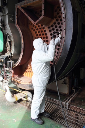 An engineer wearing ppe for an industrial boiler clean Stock Photo - 17456582