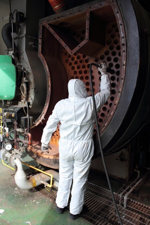regulated: An engineer wearing ppe for an industrial boiler clean