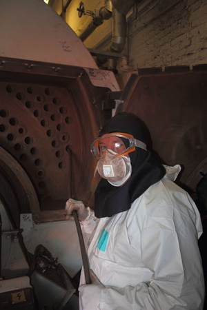 An engineer wearing ppe for an industrial boiler clean photo