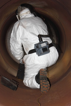 An engineer wearing ppe for an industrial boiler clean inside the furnance Stock Photo - 17456064