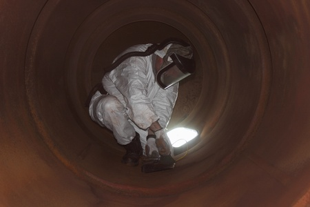 An engineer wearing ppe for an industrial boiler clean inside the furnance Stock Photo - 17456012