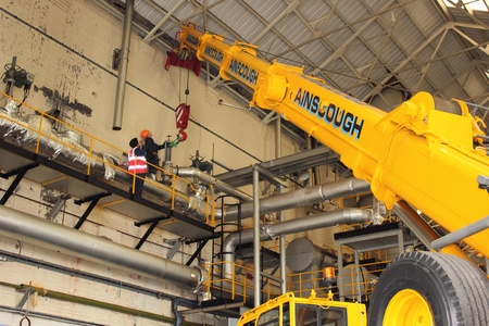 boiler house: A crane working inside a boiler house with slingers