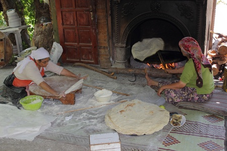 Turkish ladies making traditional bread,Turkey August 2012
