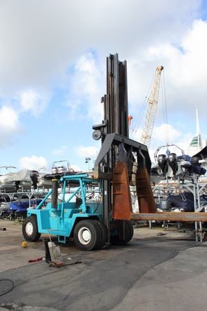 Motorboats on storage racking with fork lift