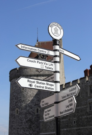 a signpost at windsor castle for the railway and information centre etc