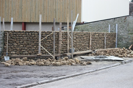 Building and repairing a stone brick wall Stock Photo - 17768170
