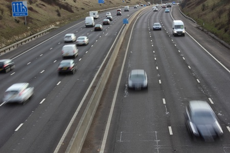 autobahn: Motorway traffic with movement blur heading towards and away from portsmouth ,england
