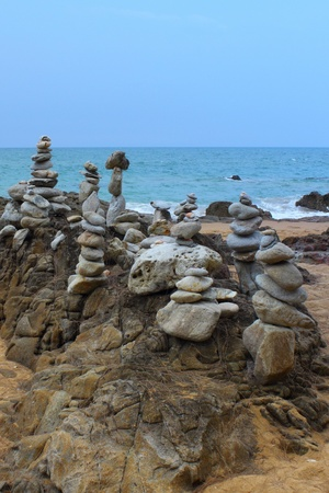Balanced stones on an Asian coastline of Thailand photo