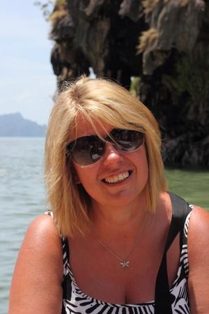 adulthood: a blond mature woman wearing sunglasses