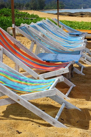Deckchairs empty on a beach in Thailand photo