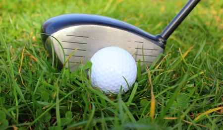 a golf ball in the grass ready to be hit Stock Photo