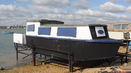 houseboat: A houseboat in portsmouth harbour in england