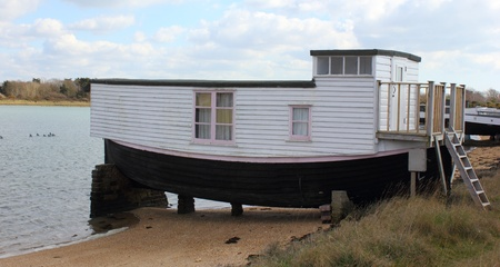 houseboat: A houseboat in langstone harbour in england Editorial
